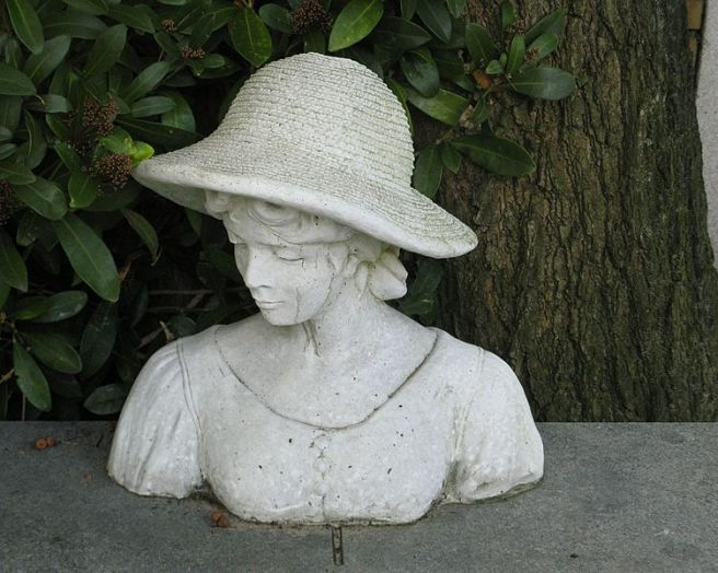 Bust_sculpture_of_a_woman_on_a_grave_in_Amsterdam by Natalie Maynor Cherokee by Mela