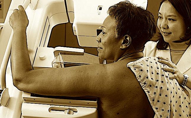750px-Woman_receives_mammogram